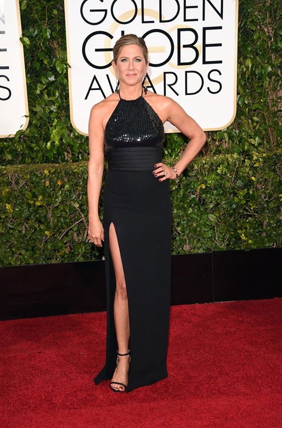 Jennifer Aniston in Saint Laurent. Yes, Jennifer Aniston. In Saint Laurent. Let's forget for a moment how boring this dress is, and reflect on the fact that Mr. Hedi I'm-too-cool-for-everyone Slimane has allowed Jennifer Aniston to wear one of this dresses on the red carpet???